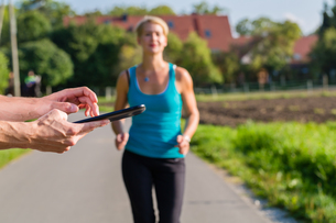 sporty couple jogging in the countryの写真素材 [FYI00687807]