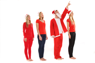 group of people in christmas costumes look into the airの写真素材 [FYI00688144]