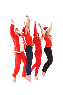 group of people in christmas costumes jumping in the airの写真素材 [FYI00688147]