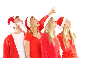 group of people in christmas costumes look into the airの写真素材 [FYI00688148]