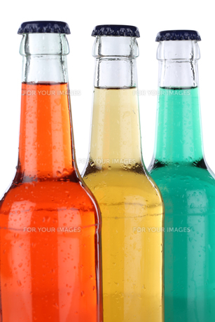 colorful drinks lemonade and soft drinks in bottles isolatedの素材 [FYI00688185]