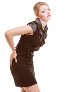 backache. young businesswoman woman blonde girl suffering from back pain isolated on white.の写真素材 [FYI00688726]