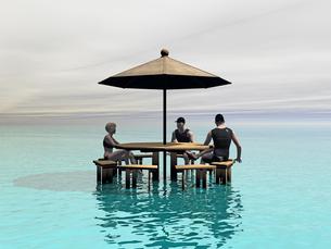 sitting under the parasolの写真素材 [FYI00690525]