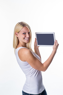 blonde with tablet in handの写真素材 [FYI00691067]