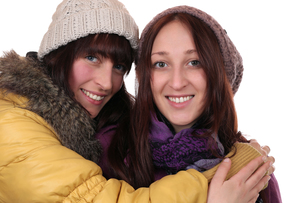 two young women in winter embraceの写真素材 [FYI00692021]