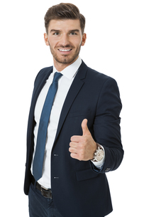 successful young businessman standing isolated in a relaxed pose with open jacketの素材 [FYI00693939]