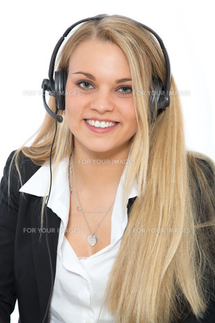 likeable woman with headset on her headの写真素材 [FYI00696874]