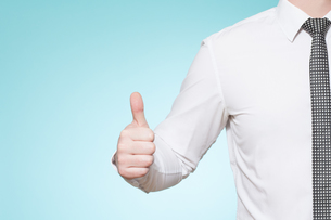 man with shirt and tie thumbs upの写真素材 [FYI00697257]