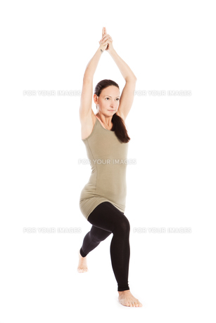 sun salutation poses in yoga against white backgroundの素材 [FYI00697628]