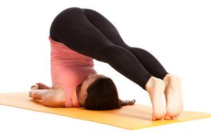 yoga exercise on the mat,halasanaの写真素材 [FYI00697639]