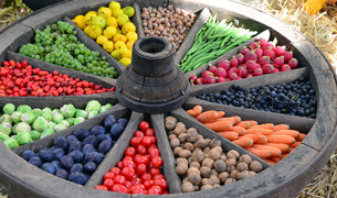 fruits and vegetables in wooden wheelの写真素材 [FYI00699404]