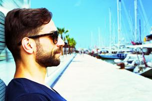 young man at the harbor in palma de mallorcaの写真素材 [FYI00699698]