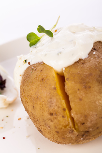 fresh sheets from the oven potato with herb quark sour creamの写真素材 [FYI00701967]