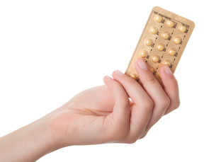 tablets (birth control pills) in the hand,isolated on white backgroundの写真素材 [FYI00702142]