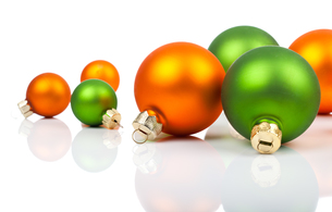 colored christmas decorations - orange and green,on a whiteの写真素材 [FYI00702210]