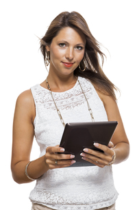 young attractive woman with tablet pc for presentation with copy spaceの写真素材 [FYI00702710]