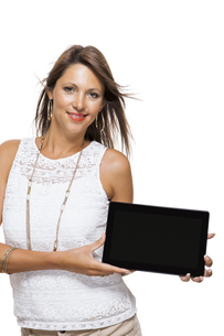 young attractive woman with tablet pc for presentation with copy spaceの写真素材 [FYI00702711]
