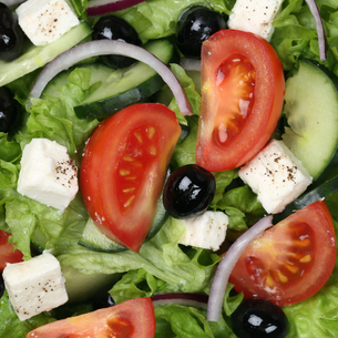 background greek salad with tomatoes,feta and olivesの写真素材 [FYI00704831]