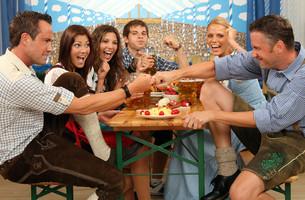 men at finger hakln in the beer tentの写真素材 [FYI00706056]