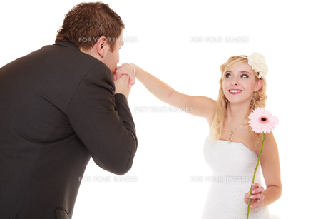 wedding day. groom kissing the hand of bride isolatedの写真素材 [FYI00707005]