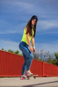 summer sports. cool girl skater riding skateboardの素材 [FYI00707028]