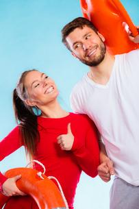 happy couple with lifeguard equipmentの写真素材 [FYI00707062]