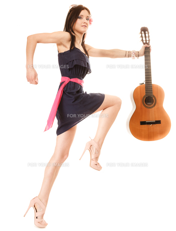 music lover,summer girl with guitar isolatedの写真素材 [FYI00707760]