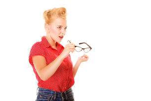 retro hairstyle beautiful girl holds glasses isolatedの写真素材 [FYI00707777]