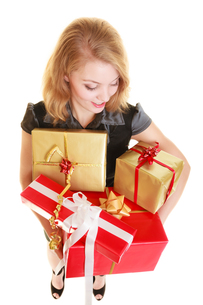 holidays love happiness concept - girl with gift boxesの写真素材 [FYI00707787]