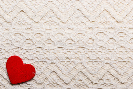 red heart symbol love on lace backgroundの素材 [FYI00707833]