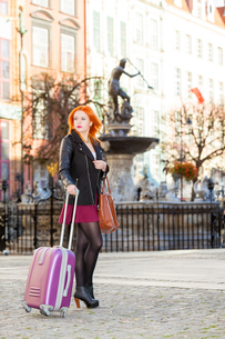 woman fashion girl with suitcase bag outdoorの写真素材 [FYI00707888]