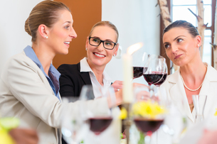business in the restaurant with food and wineの写真素材 [FYI00708393]