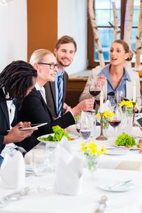 team business meals in the restaurantの写真素材 [FYI00708402]
