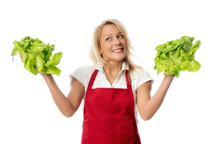 woman with apron presenting lettuceの写真素材 [FYI00709658]