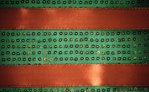green sequin background texture abstract textile cloth and red ribbonの写真素材 [FYI00709730]