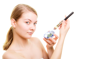 skin care. woman applying clay mud mask on face.の写真素材 [FYI00709732]