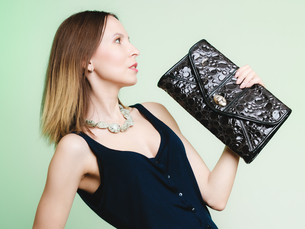elegant outfit. stylish woman with black handbagの写真素材 [FYI00709739]