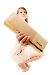 elegance. full length of a girl showing elegant handbagの写真素材 [FYI00710661]