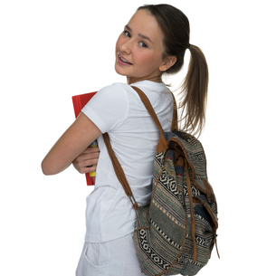 Young schoolgirl carrying a book and backpackの写真素材 [FYI00716352]
