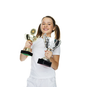 Proud young girl holding two trophiesの写真素材 [FYI00716357]
