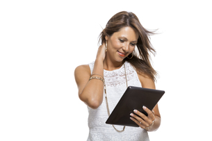 young attractive woman with tablet pc for presentation with copy spaceの写真素材 [FYI00718357]