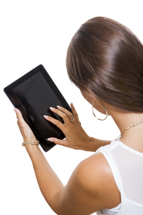 young attractive woman with tablet pc for presentation with copy spaceの写真素材 [FYI00718359]