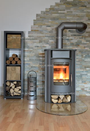 fireplace with wood burning stove and rindenbriketts.wood with fire-wood andの写真素材 [FYI00724055]