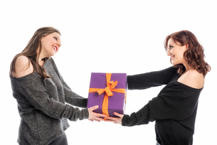 a girl handed her friend a giftの写真素材 [FYI00727982]