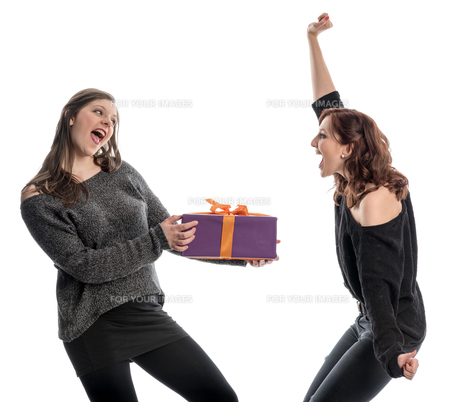 two girls are happy about a gift and cheerの写真素材 [FYI00738801]