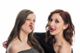 two girlfriends drag schnutenの写真素材 [FYI00738809]