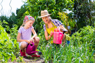 mother and daughter in the garden at gardeningの写真素材 [FYI00739469]
