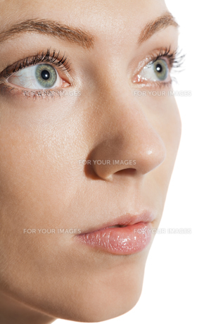 closeup of a female face with eyes lips nose and eyebrowsの写真素材 [FYI00739483]