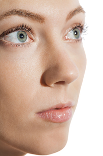 closeup of a female face with eyes lips nose and eyebrowsの素材 [FYI00739483]
