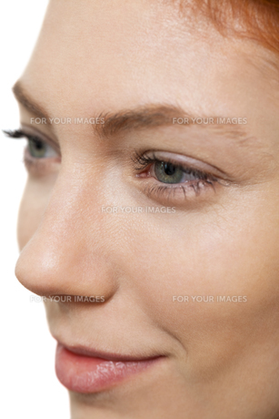 closeup of a female face with eye lips nose and eyebrowsの写真素材 [FYI00740395]
